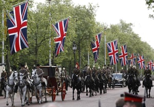 Royal Wedding rehearsal: Mounted soldiers escort a carriage down The Mall