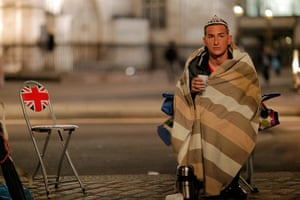Royal Wedding rehearsal: A Royal fan sits in front of Westminster Abbey