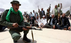 Libyan men wave weapons as they attend a defence and security workshop