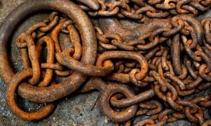 Rusted chain in a scrapyard