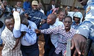 Ugandan opposition leader Kizza Besigye is arrested by police in Kampala