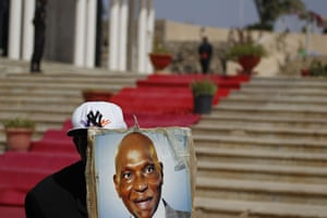 Africa Unrest: A Senegalese supporter of Abdoulaye Wade holds the president's portrait