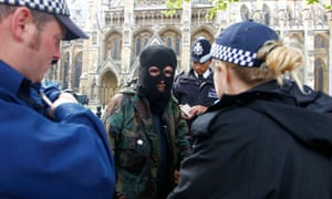 A man is questioned by police outside Westminster Abbey ahead of the royal wedding