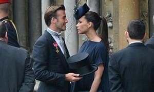 David Beckham and Victoria Beckham arrive to attend the Royal Wedding