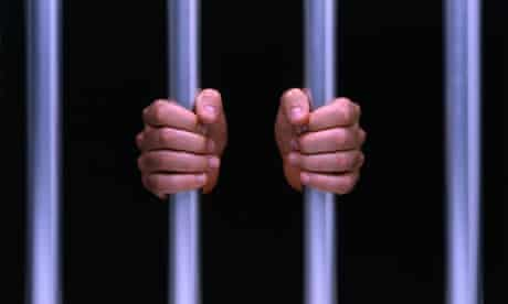 Prisoners' hand hold on to prison bars