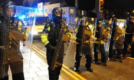 Police officers form a barricade during during demonstrations in Stokes Croft, Bristol