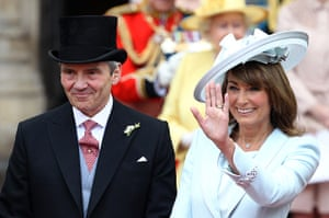 Wedding procession: Michael and Carole Middleton smile and wave