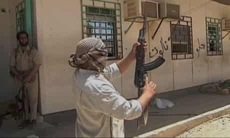 A Libyan rebel fires into the air to celebrate capturing the Dhuheiba border crossing with Tunisia