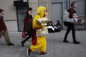 Pillow fight day: New York City, USA: A person in a chicken suit walks down the street