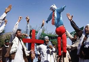 Afghanistan protests: 3 April: Afghan protestors hold an effigy of President Obama in Jalalabad