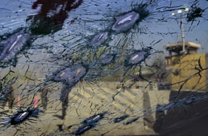 Afghanistan protests: Afghan soldiers are seen through the front window of a car