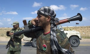 Rebel Libyan fighters in Brega on their way to battle against loyalist troops