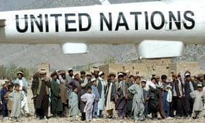 Afghan villagers with a UN helicopter in 2004