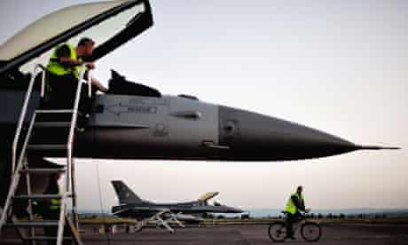 A Danish F-16 strike aircraft is reviewed after a mission over Libya in the Nato campaign