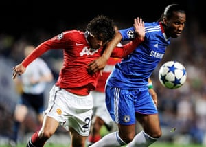 Chelsea v United: Didier Drogba holds off the challenge from Rafael