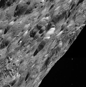 A month in space: Craggy Craters on Rhea