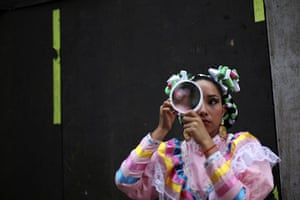 24 hours in pictures: A woman dressed as an Adelita in Mexico City