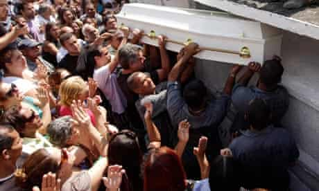 Relatives and friends of shooting victim Larissa Silva Martins attend her funeral in Rio