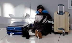A passenger waiting for an international flight at an airport terminal