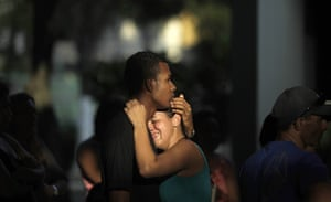 24 Hours in Pictures: Friends of shooting victim Igor Moraes da Silva attend the funeral in Rio