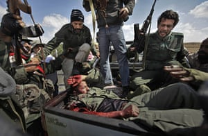 24 Hours in Pictures: A wounded prisoner from Gaddafi's forces in the back of a pickup truck