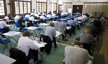 GCSE-age schoolchildren sitting an exam in a school hall at Maidstone grammar school, Norfolk