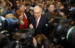 Berkshire Hathaway: Berkshire Hathaway Chairman Warren Buffett, holding an ice cream bar