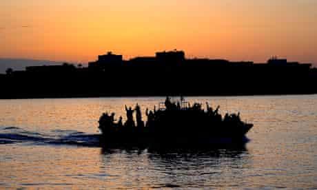A boat carring Tunisian migrants enters Lampedusa