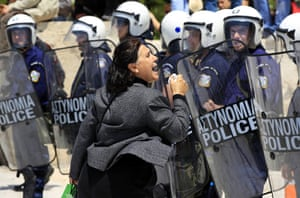 Protests in Athens: A woman shouts at policemen in front of the Greek parliament