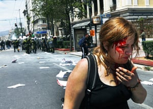 Protests in Athens: An injured protester bleeds following clashes with riot police in Athens