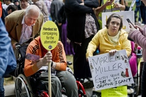 Hardest Hit march: Wheelchair users with placards