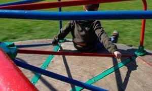 Boy playing on a roundabout