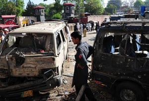 Pakistan Bomb Attacks: Pakistani security officials examine the wreckage of vehicles