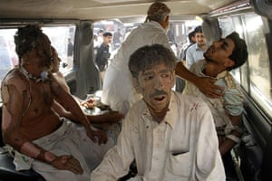 Pakistan Bomb Attacks: People injured in suicide bomb attacks are rushed to hospital in Peshawar
