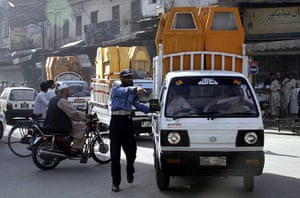 Pakistan Bomb Attacks: Rescue workers transport coffins of the victims of suicide bombs, Pakistan