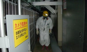 A worker inside the No 1 reactor building at Fukushima Daiichi nuclear power plant