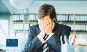 stressed man at desk