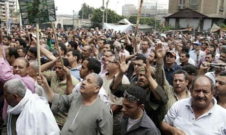 Coptic Christians demonstrate in front of the state television building in Cairo