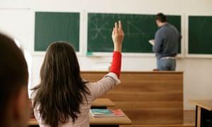 Teacher writing on blackboard for Leo Blog