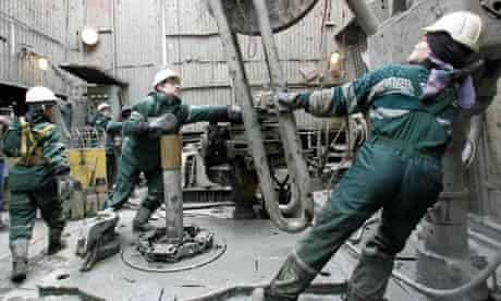 Rosneft staff work at the Yuganskneftegaz oil production station near Nefteyugansk