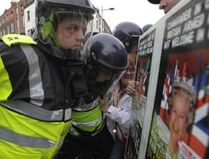 The Queen visits Ireland: Garda are seen as demonstrators make their way down a street