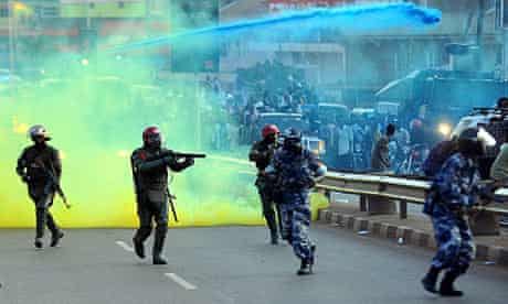 Ugandan anti-riot personnel fire teargas to disperse supporters of opposition leader Kizza Besigye