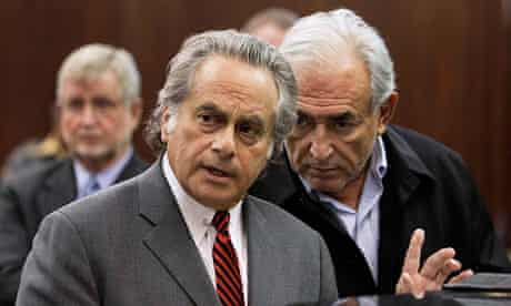 Strauss-Kahn consults with his lawyer Benjamin Brafman as he appears in Manhattan Criminal Court