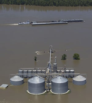 Mississippi floods: A barge travels down the Mississippi River near Natchez