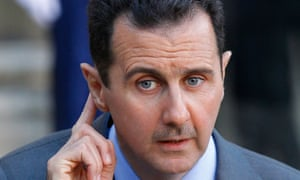 File picture of Syria's President Bashar al-Assad listening to questions from journalists in Paris