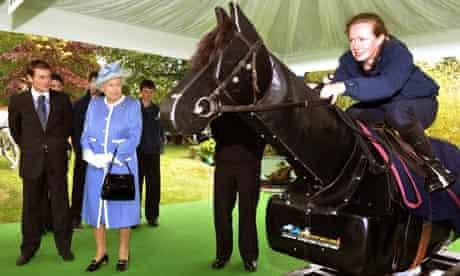 Queen Elizabeth II and Jonny Murtagh watch a demonstration at the Irish National Stud