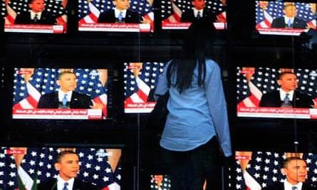 Egyptian woman watches Obama