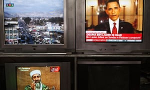 News telecasts are broadcasted on television sets at a store in Kabul