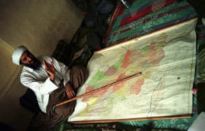 Osama bin Laden: 1998: Exiled Saudi dissident Osama bin Laden sits by a map of Afghanista