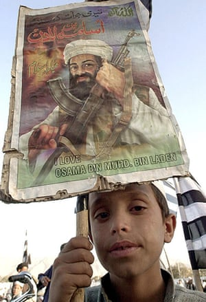 Osama bin Laden: 2002: A young supporter holds a poster with a portrait of Osama bin Laden